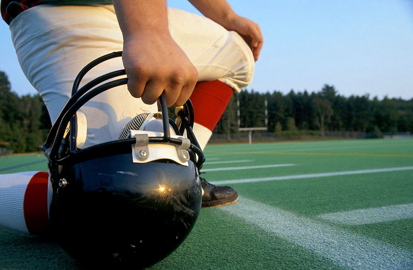 Football player on sidelines